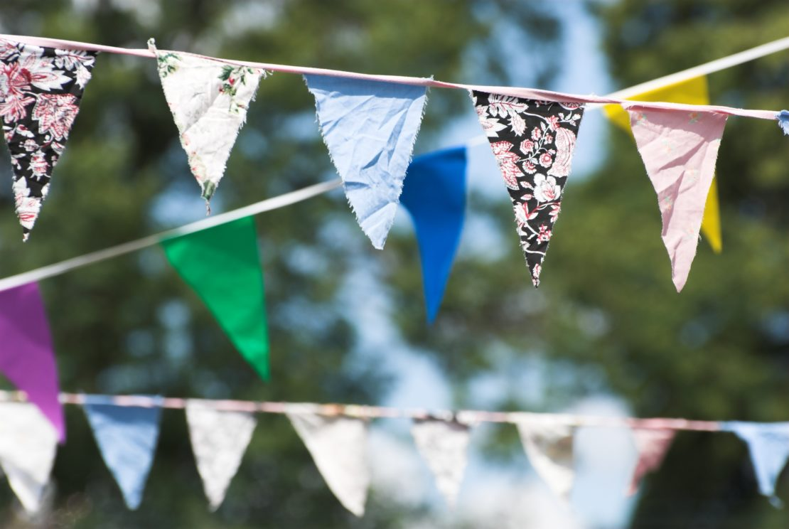 garden treasure hunt ideas - tie strings of pretty bunting in multi-coloured fabric to keep players in certain areas