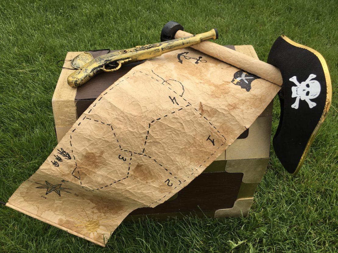 treasure map treasure chest pirate gun and pirate hat