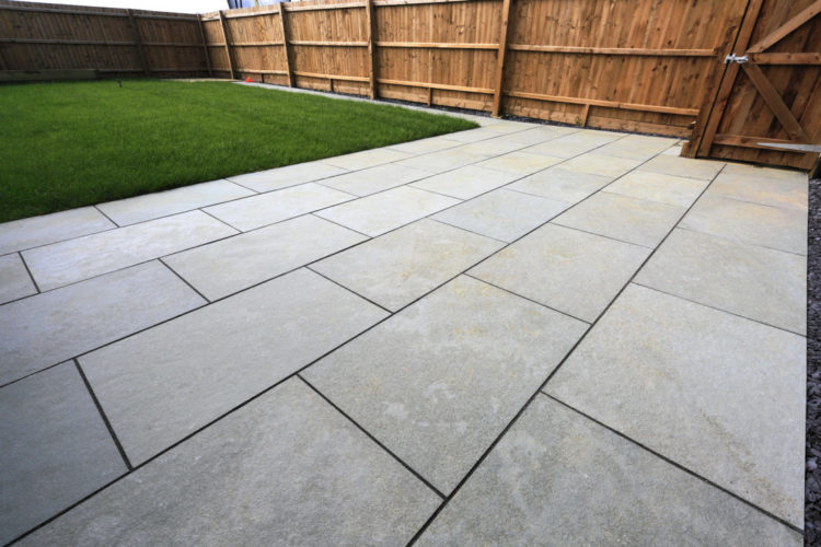 a close-up of a sleek patio made from grey paving stones