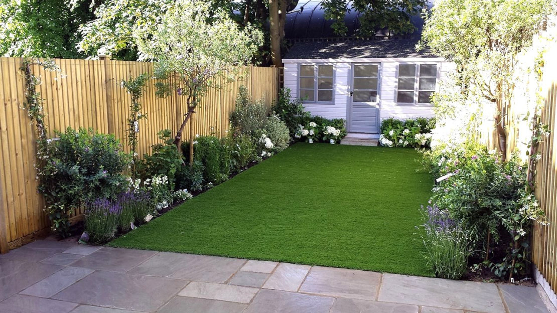 low-maintenance garden ideas with an artificial lawn, flower beds and a garden shed