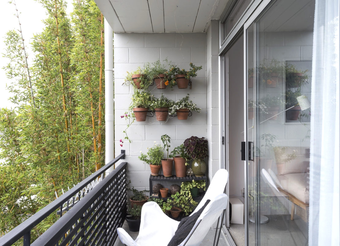 garden balcony ideas with painted bright white, with potted plants on the wall