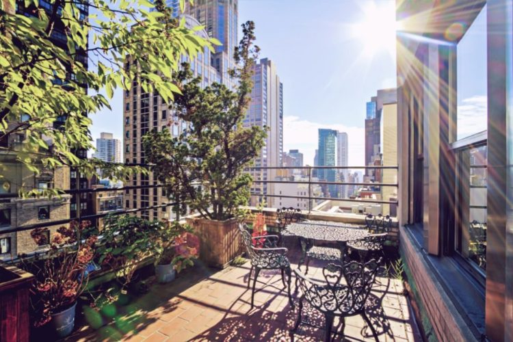 A balcony garden in New York, filled with plants and patio furniture