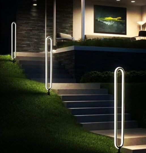 modern, oval-shaped lawn lights leading up a garden path