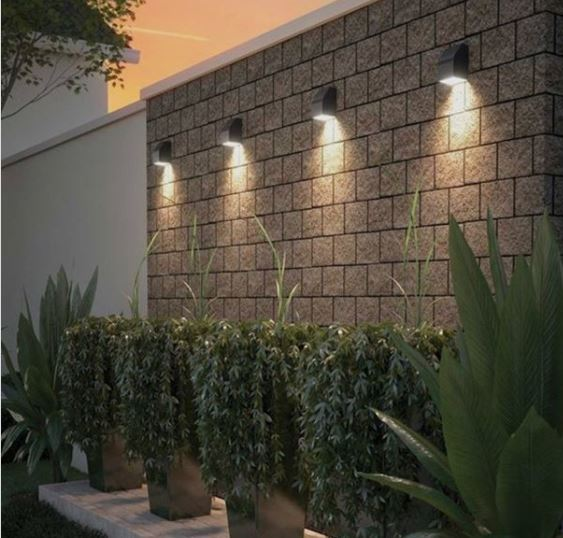four spotlights along a garden wall, pointing dowards at the bottom plants below, making them look very dramatic