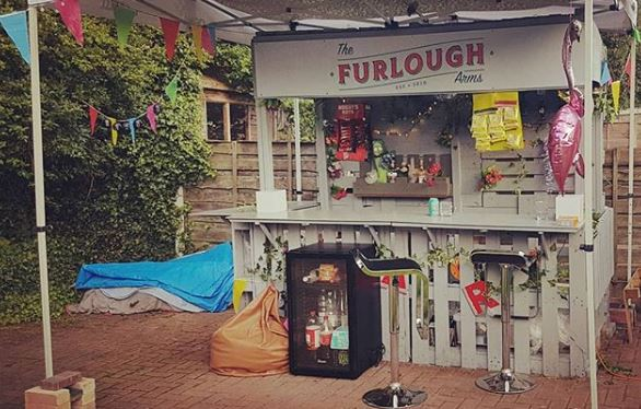 A garden bar with a sign saying the Furlough Arms