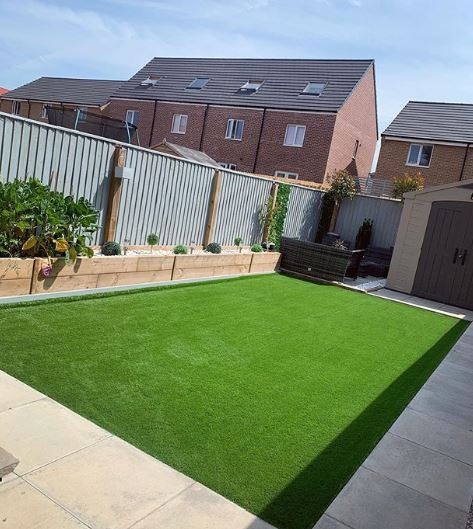 An immaculate rectangle of synthetic lawn. It's perfectly level and a very even shade of green.