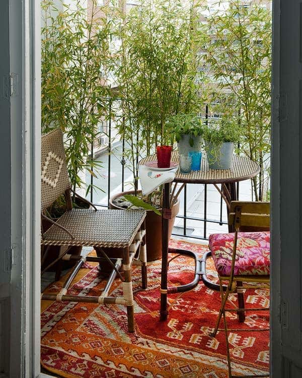 Boho balcony with bamboo privacy screen