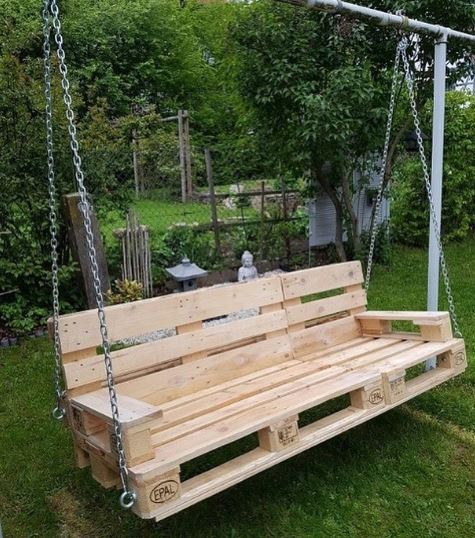 A DIY garden swing bench made from stripped wooden pallets