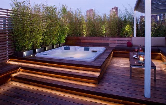 a luxurious sunken hot tub on a wooden deck in London