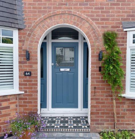 a door step with cobalt blue tiles, matching the pretty cobalt blue front door