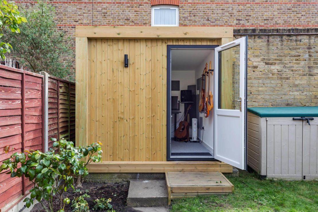 garden man cave ideas - a recording studio inside a boxy, modern garden shed