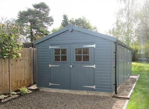 a large wooden shed with double doors at one end - perfect for getting vehicles in and out