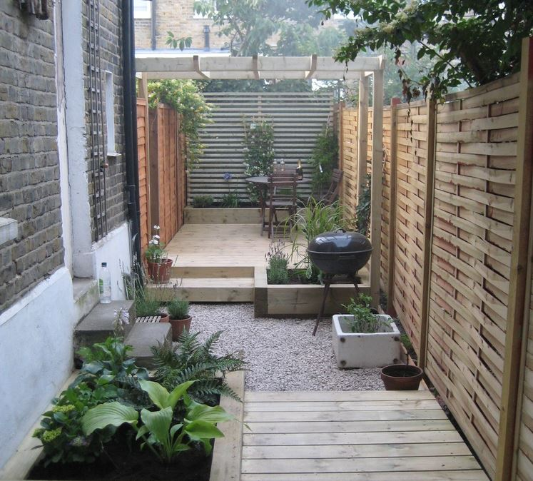 a narrow side-garden divided into sections of decking and gravel, making each area more practical