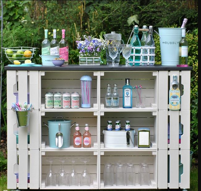 a pretty garden bar stocked with soft drinks, fruit and decorated with flowers