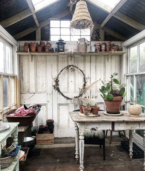 a rustic, shabby chic potting shed made from reclaimed materials