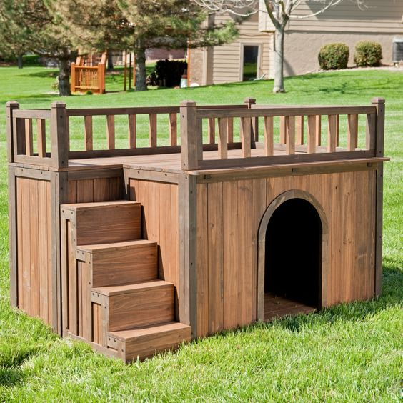 a two-storey DIY dog house in a garden