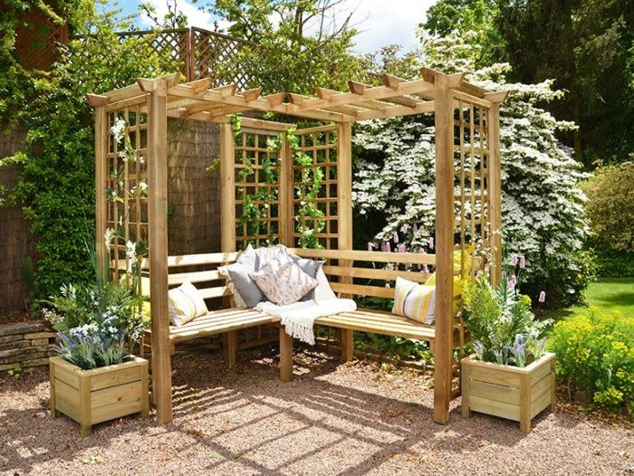 an L-shaped arbour with corner bench and trellises up the sides