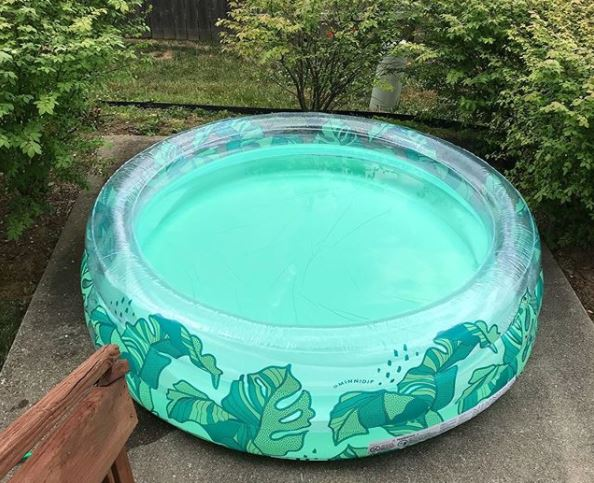 an adult-sized inflatable paddling pool, in a fun, tropical leaf print