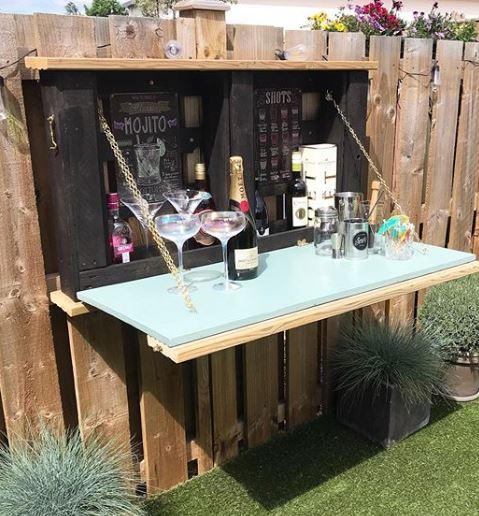 an unfolded murphy bar, showing bottles inside