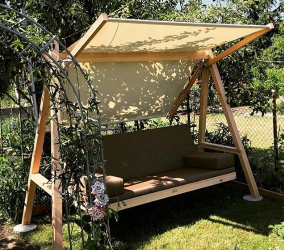 a contemporary garden swing bench with an adjustable canopy
