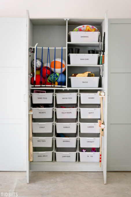 garage toy storage cabinet with bungee section