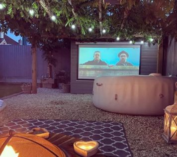 garden cinema ideas with hot tub and fire pit