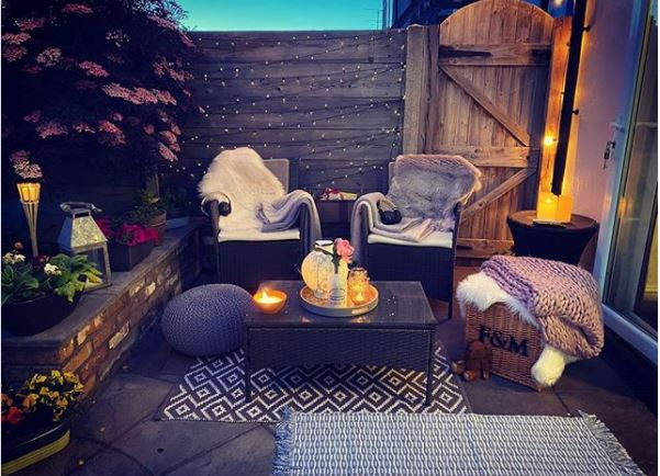 garden cinema seating with blankets and fairy lights