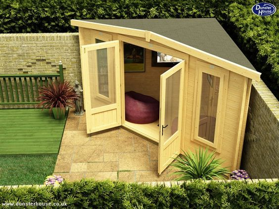 garden woman cave ideas - a triangular shed in the corner of a patio