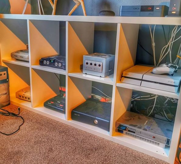 man cave shelving, with each shelf housing a different games console