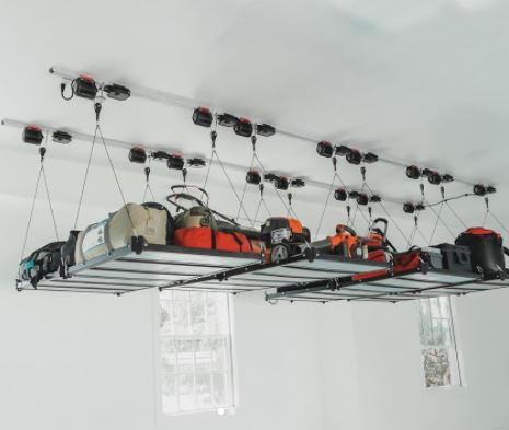 overhead storage rack in a garage, with boxes and outdoor equipment on top