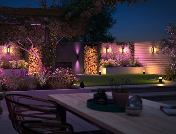 a stylish garden with multiple lights set to different colours and intensities