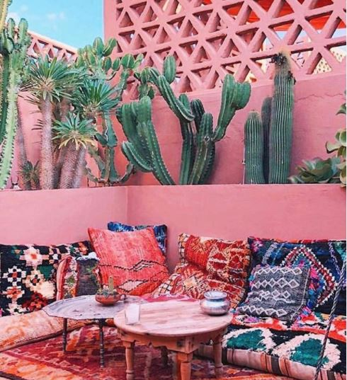 rooftop garden ideas - a moroccan themed rooftop garden painted salmon pink