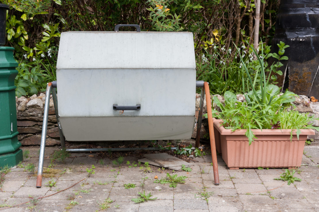 An octagonal metal bin that would rotate on a horizontal axis to turn the compost inside