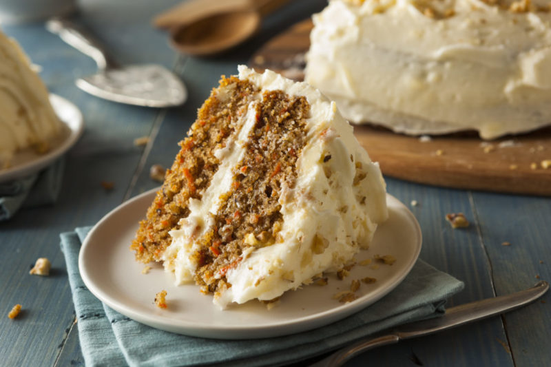 a wedge of home made carrot cake with thick icing