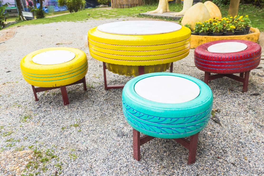 old tyres have been turned into brightly painted stools and a low table