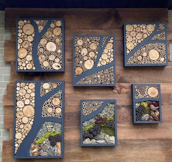 six rectangular bug hotels have been artfully arranged to look like a tree branch