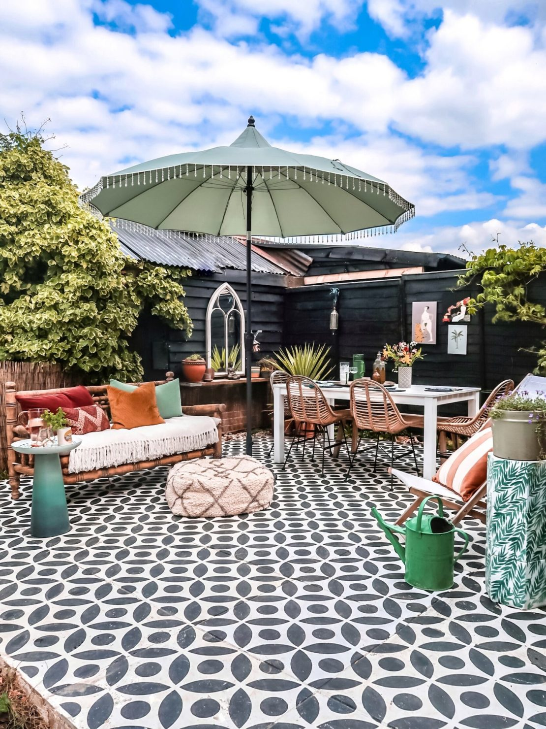 a concrete patio with a black and white pattern painted across it