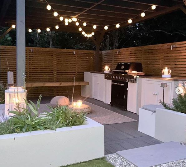 outdoor kitchen ideas with a gazebo garden lighting and seating