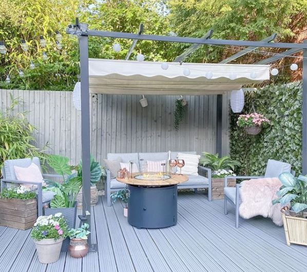 a stylish grey deck with a pergola to relax under