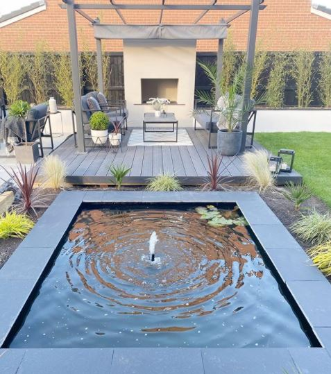Spanish themed garden ideas including a square pool and fountain in the middle of the garden