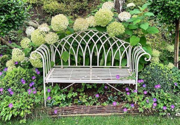 an ornate garden bench made from metal