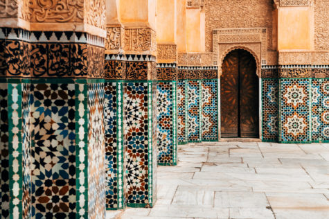 a moroccan wall heavily detailed with zillige tiles in patterns