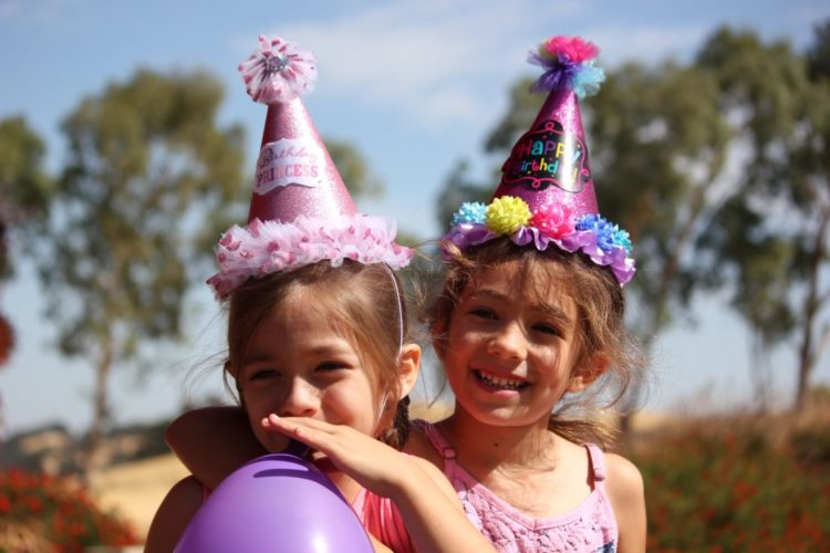 two girls in party hats