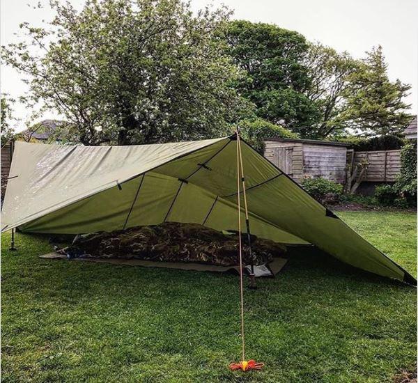a tarpaulin shelter for adventurous garden camping ideas