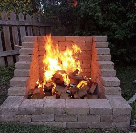 DIY fire pit with an open front made using pale bricks