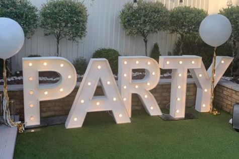 garden party ideas for decorations: large light up letters