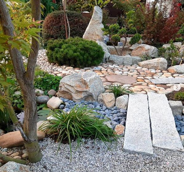 Japanese garden ideas and grass-free garden ideas with blue rocks representing a river