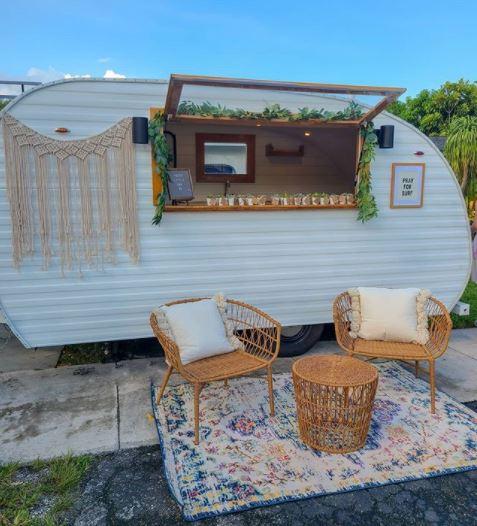 a retro camping trailer converted into a garden shed bar