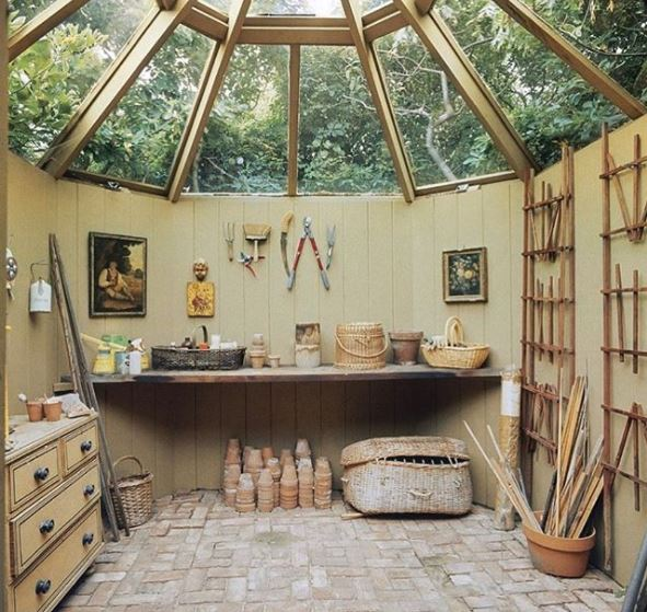 an octagonal garden potting shed with a glass roof