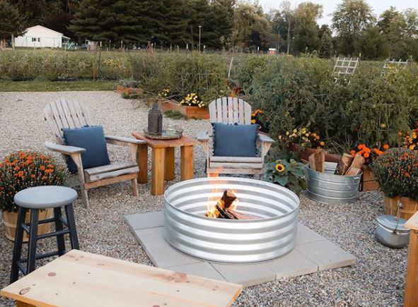 garden furniture arranged around a DIY metal fire pit